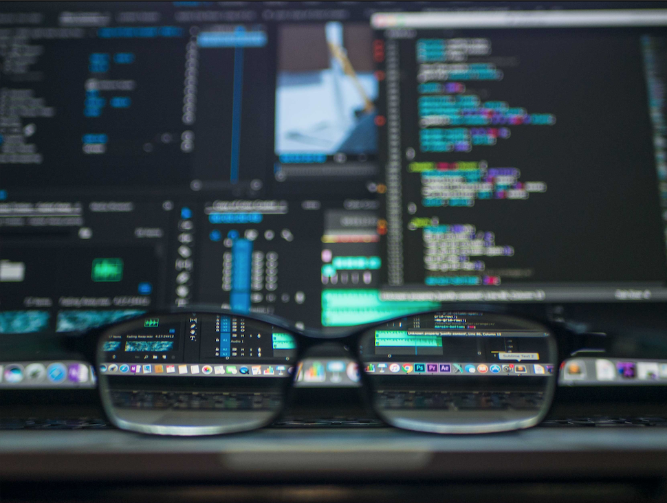 glasses in front of a computer screen