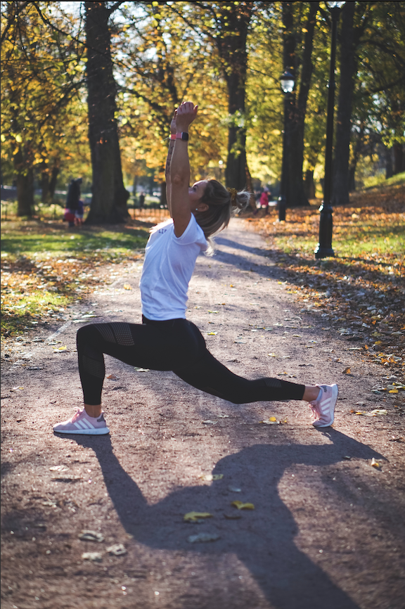 woman exercising with a wearable device